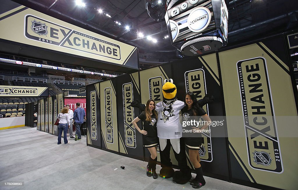 PIttsburgh Penguins mascot Iceburgh tours around the booths with Penguins ice girls during 2013 NHL Exchange the annual NHL Licensed Products forum at the Consol Energy Center on July 30, 2013 in Pittsburgh, Pennsylvania.
