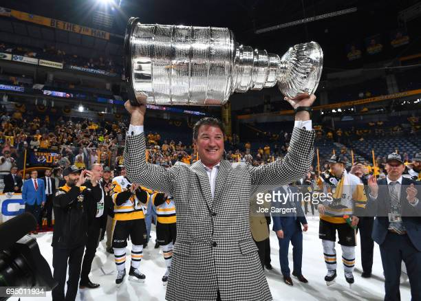 Pittsburgh Penguins owner Mario Lemieux lifts the Stanley Cup after Game Six of the 2017 NHL Stanley Cup Final at the Bridgestone Arena on June 11...