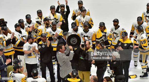 Pittsburgh Penguins owner Mario Lemieux raises the Stanley Cup Trophy after defeating the Nashville Predators 20 in Game Six of the 2017 NHL Stanley...
