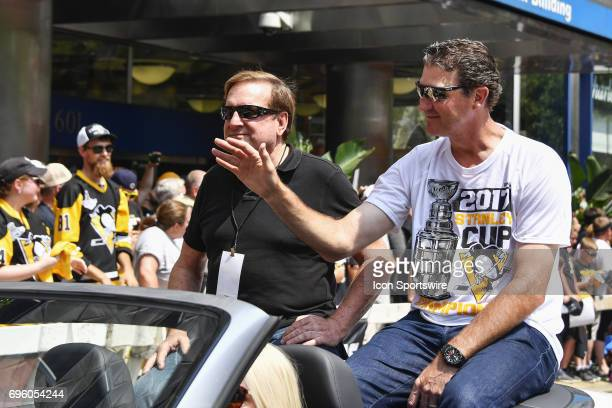 Pittsburgh Penguins owners Ron Burkle and Mario Lemieux wave to fans during the 2017 Pittsburgh Penguins Stanley Cup Champion Victory Parade on June...