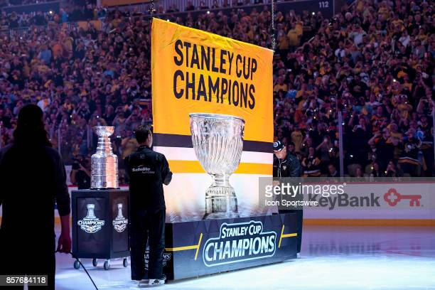 Pittsburgh Penguins raise the 2017 Stanley Cup Champions banner prior to the NHL game between the Pittsburgh Penguins and the St Louis Blues on...