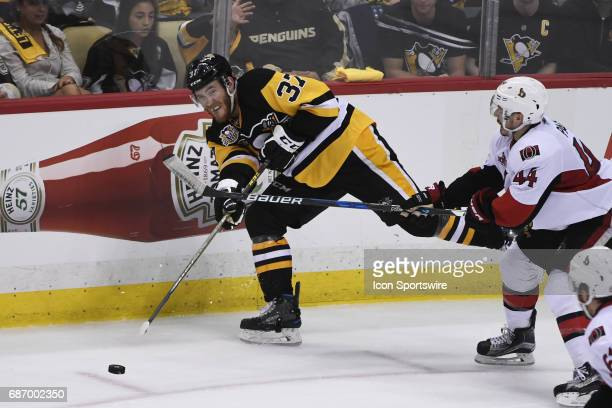 Pittsburgh Penguins right wing Carter Rowney moves the puck in front of Ottawa Senators center JeanGabriel Pageau during the second period The...