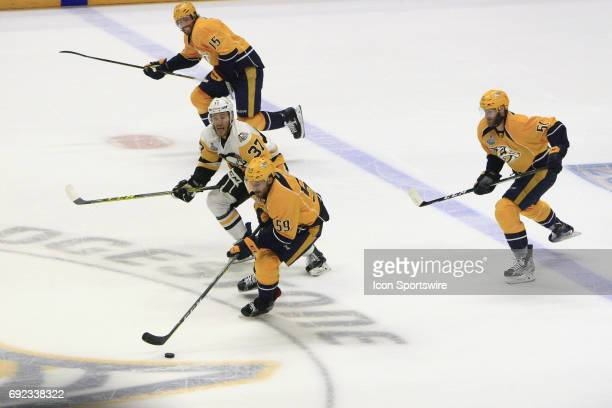 Pittsburgh Penguins right wing Carter Rowney pursues Nashville Predators defenseman Roman Josi during Game 3 of the Stanley Cup Final between the...