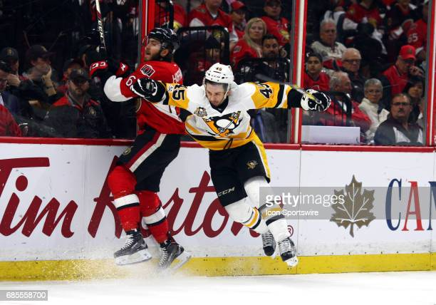 Pittsburgh Penguins Right Wing Josh Archibald goes in for a hit on Ottawa Senators Right Wing Mike Hoffman in the second period of Game 4 of the...