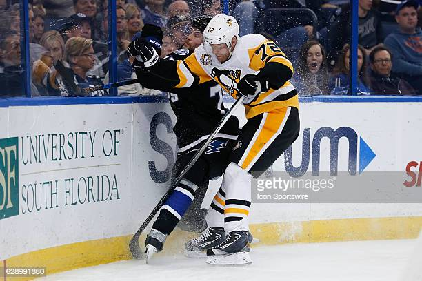 Pittsburgh Penguins right wing Patric Hornqvist checks Tampa Bay Lightning defenseman Victor Hedman into the boards behind the Lightning net in the...