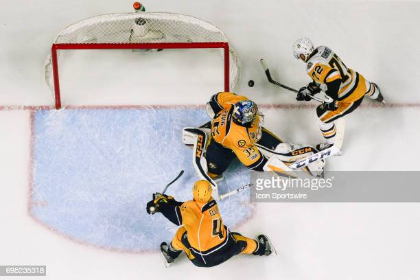 Pittsburgh Penguins right wing Patric Hornqvist prepares to shoot winning goal against Nashville Predators goalie Pekka Rinne during game 6 of the...