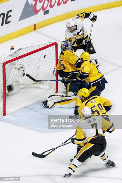 Pittsburgh Penguins right wing Patric Hornqvist scores winning goal against Nashville Predators goalie Pekka Rinne during game 6 of the 2017 NHL...