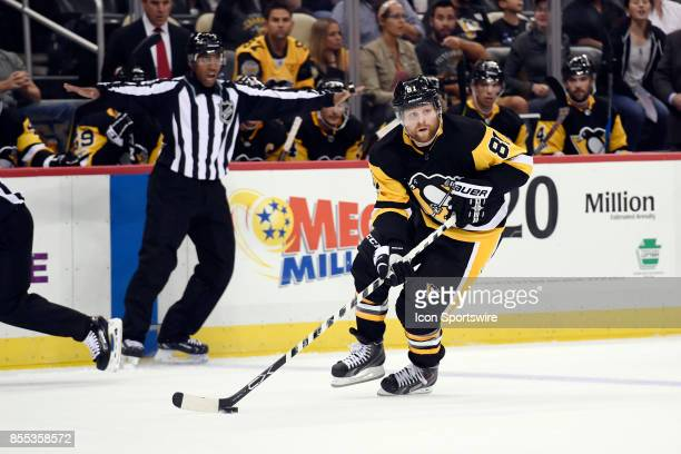 Pittsburgh Penguins right wing Phil Kessel skates with the puck during the second period in the NHL preseason game between the Pittsburgh Penguins...