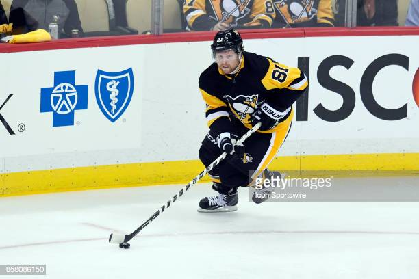 Pittsburgh Penguins right wing Phil Kessel skates with the puck during the second period in the NHL game between the Pittsburgh Penguins and the St...