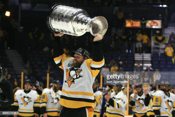 Pittsburgh Penguins right wing Phil Kessel skates with the Stanley Cup following Game 6 of the Stanley Cup Final between the Nashville Predators and...