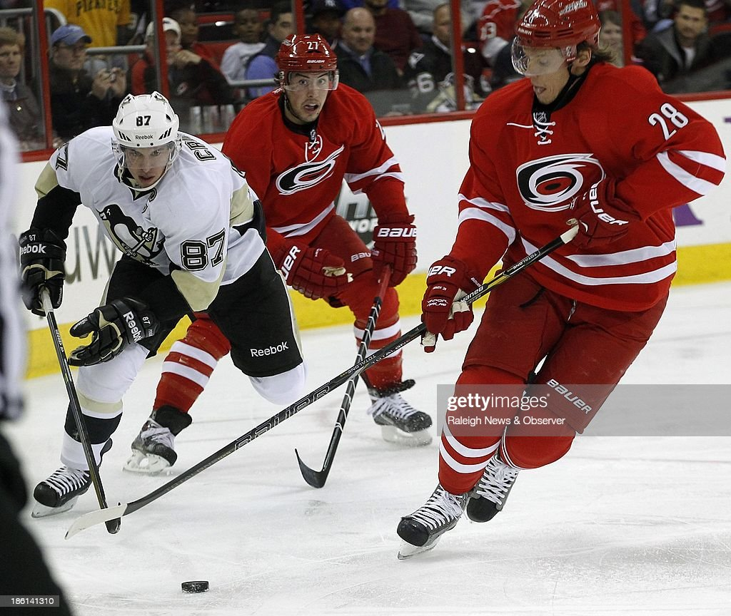 Pittsburgh Penguins' Sidney Crosby (87) battles Carolina Hurricanes' Justin Faulk (27) and Alexander Semin (28) for the puck during the first period at the PNC Arena in Raleigh, North Carolina, on Monday, October 28, 2013.