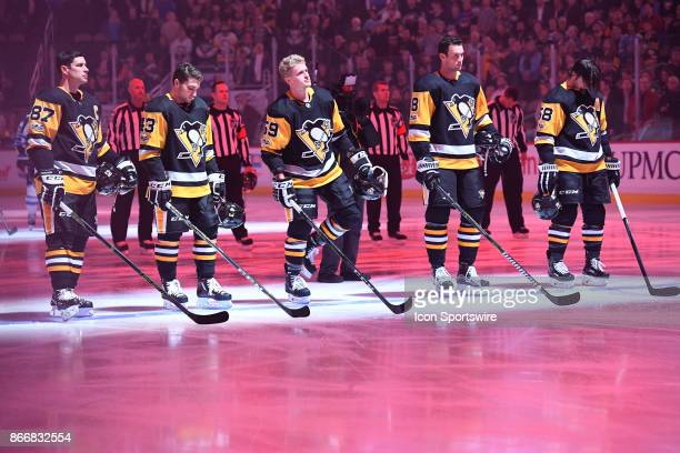 Pittsburgh Penguins starting line up of center Sidney Crosby left wing Conor Sheary center Jake Guentzel defenseman Brian Dumoulin and defenseman...