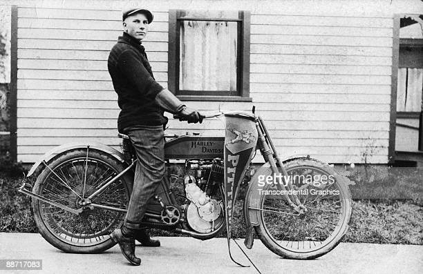 A Pittsburgh Pirate fan decorates his early Harley Davidson motorcycle with a pennant proclaiming his allegiance to the team 1910