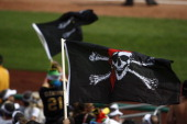 Pittsburgh Pirate fans fly the Jolly Roger flag during the victory over the Miami Marlins on Sunday July 22 2012 at PNC Park in Pittsburgh...