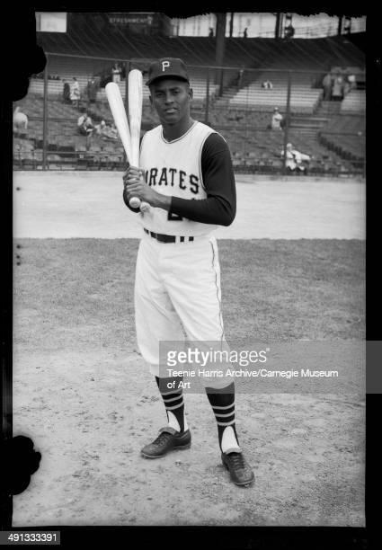 Pittsburgh Pirates baseball player Roberto Clemente holding bats on Forbes Field Pittsburgh Pennsylvania circa 19641966