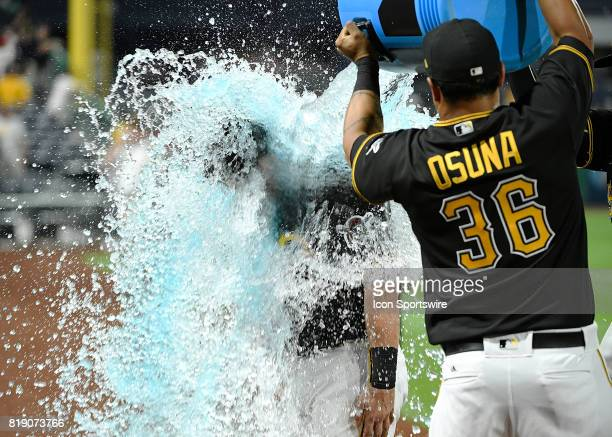Pittsburgh Pirates catcher Francisco Cervelli is doused with Powerade by right fielder Jose Osuna and first baseman Josh Bell after the Pittsburgh...