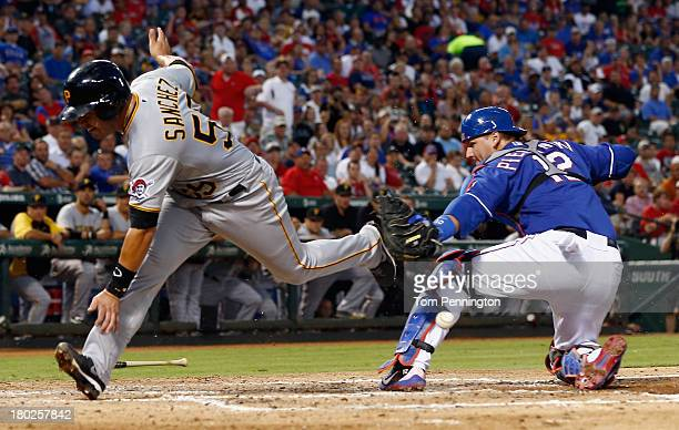 Pittsburgh Pirates catcher Tony Sanchez collides with Texas Rangers catcher AJ Pierzynski against the Texas Rangers at the plate to score a run on a...