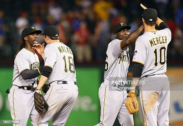 Pittsburgh Pirates center fielder Andrew McCutchen and Pittsburgh Pirates left fielder Felix Pie celebrate with Pittsburgh Pirates second baseman...