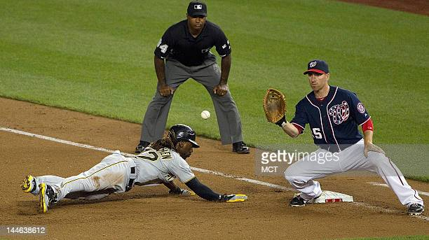 Pittsburgh Pirates center fielder Andrew McCutchen gets back to first base safely before the tag by Washington Nationals first baseman Adam LaRoche...