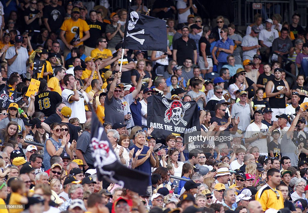 Pittsburgh Pirates fans celebrate during the game against the St. Louis Cardinals during the game on July 30, 2013 at PNC Park in Pittsburgh, Pennsylvania. The Pirates defeated the Cardinals 2-1 in eleven innings.