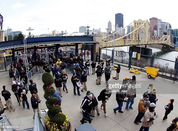 Pittsburgh Pirates fans enter the ballpark before opening day between the St Louis Cardinals and the Pittsburgh Pirates at PNC Park on April 3 2016...