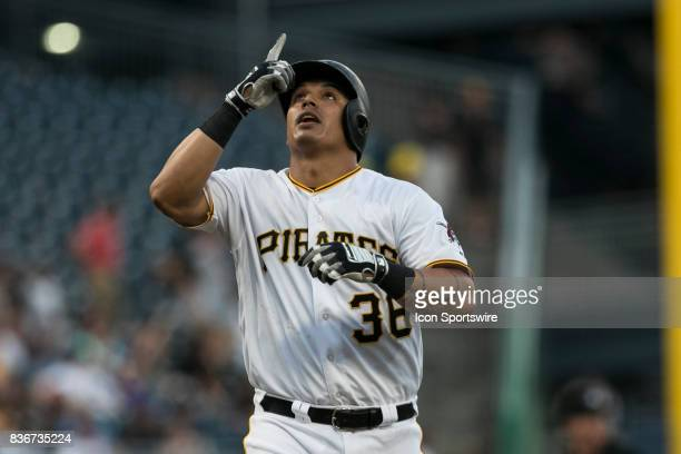 Pittsburgh Pirates First base Jose Osuna points to the sky after hitting a home run during a game between the Los Angeles Dodgers and the Pittsburgh...