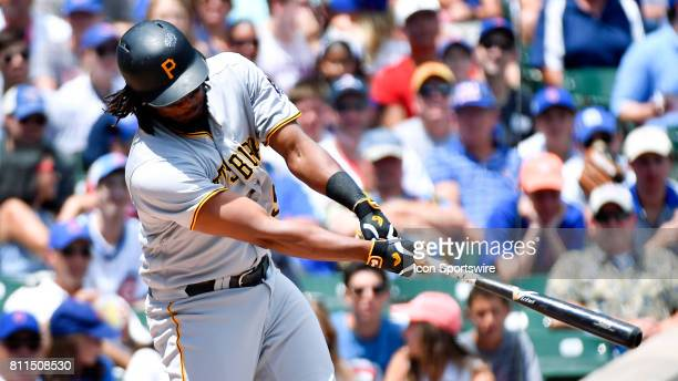 Pittsburgh Pirates first baseman Josh Bell hits the ball for an RBI single during the game between the Pittsburg Pirates and the Chicago Cubs on July...