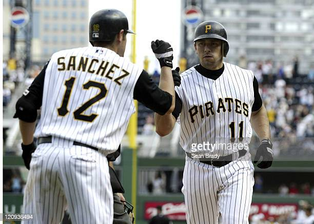 Pittsburgh Pirates Humberto Cota is greeted by his teammate Freddy Sanchez after hitting a game tieing solo home run in the bottom of the 9th against...