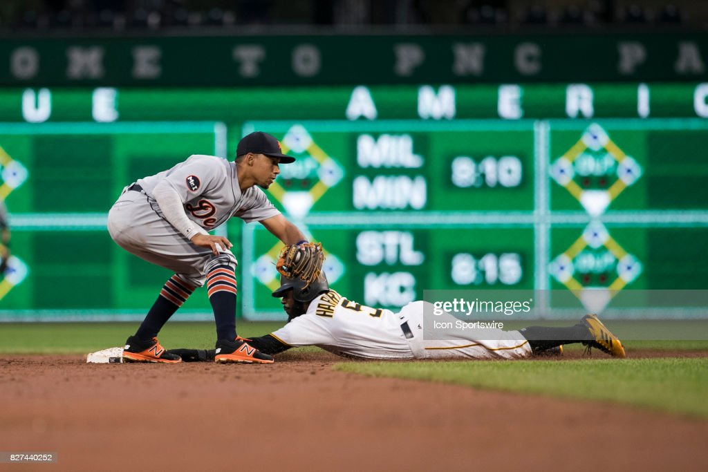 Pittsburgh Pirates Infield Josh Harrison (5) is safe at second base and avoids the tag by Detroit Tigers Infield Dixon Machado (49) during the Major League Baseball game between the San Francisco Giants and the Pittsburgh Pirates on August 7, 2017, at PNC Park in Pittsburgh Pa.