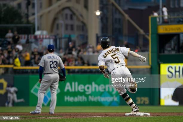 Pittsburgh Pirates Infield Josh Harrison rounds first base after hitting a home run during a game between the Los Angeles Dodgers and the Pittsburgh...