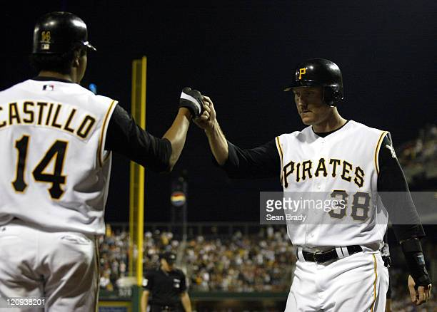 Pittsburgh Pirates Jason Bay is greeted after crossing home plate by teammate Jose Castillo durng action against the Baltimore Orioles on June 8 2005...