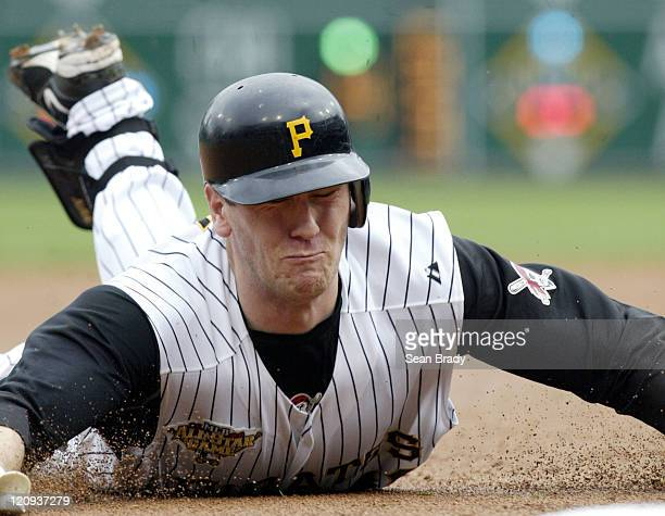 Pittsburgh Pirates Jason Bay slides into third base for a triple during action against San Diego at PNC Park in Pittsburgh Pennsylvania on June 4 2006