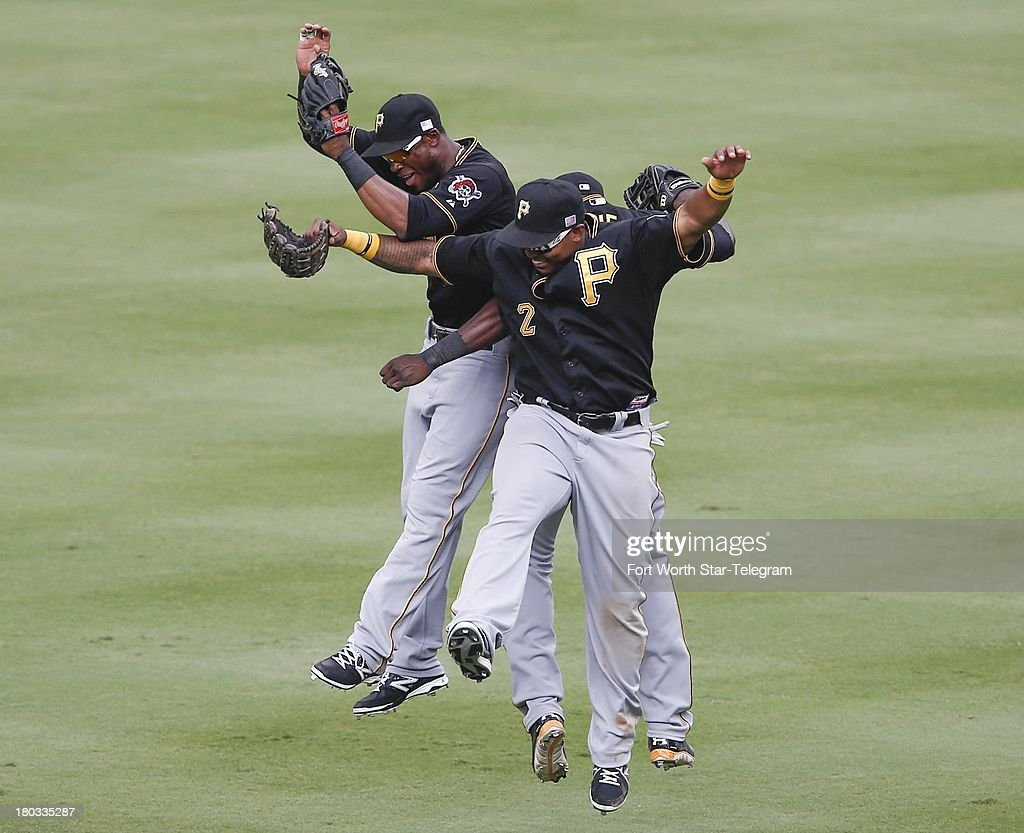 Pittsburgh Pirates left fielder Starling Marte, left, right fielder Marlon Byrd, right, and center fielder Felix Pie, right rear, celebrate their win over the Texas Rangers at Rangers Ballpark in Arlington, Texas, on Wednesday, September 11, 2013. The Pirates won, 7-5, sweeping the series.