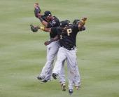 Pittsburgh Pirates left fielder Starling Marte left right fielder Marlon Byrd right and center fielder Felix Pie right rear celebrate their win over...