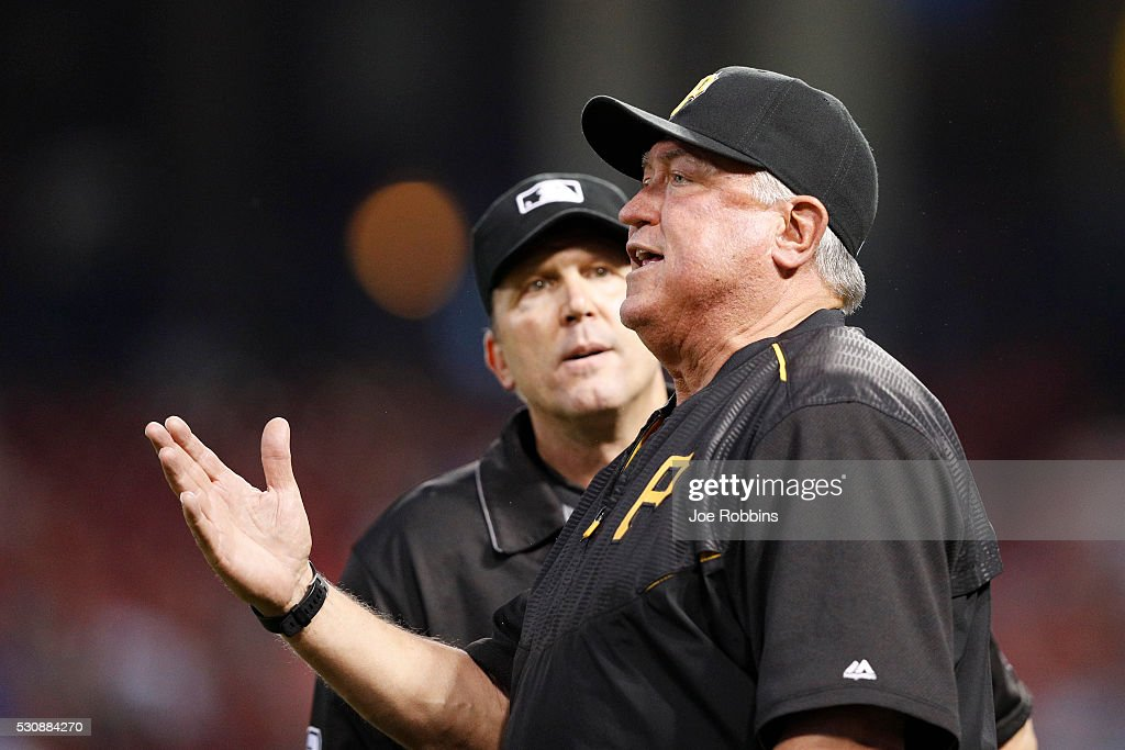 Pittsburgh Pirates manager Clint Hurdle argues with an umpire in the sixth inning of the game against the Cincinnati Reds at Great American Ball Park...