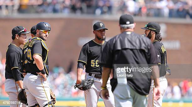 Pittsburgh Pirates manager Clint Hurdle walks to the mound to make a pitching change replacing Antonio Bastardo during the eighth inning of the...