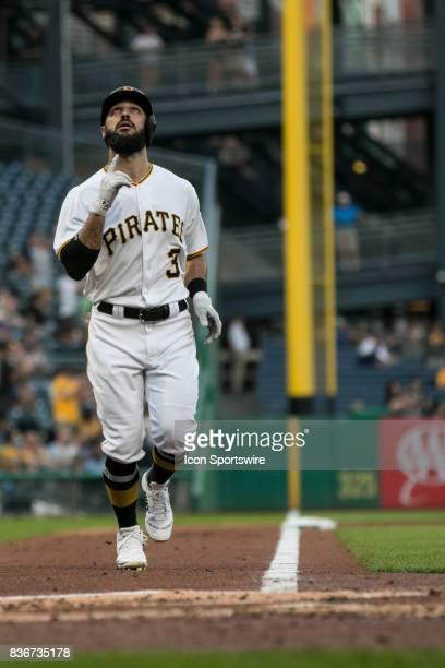 Pittsburgh Pirates Outfield Sean Rodriguez points to the sky after hitting a home run during a game between the Los Angeles Dodgers and the...