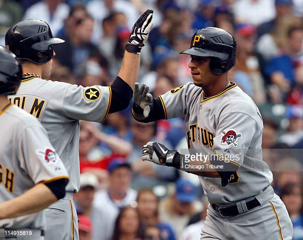 Pittsburgh Pirates Paul Maholm left high fives teammate Ronny Cedeno following Cedeno's threerun home run against the Chicago Cubs in the fourth...