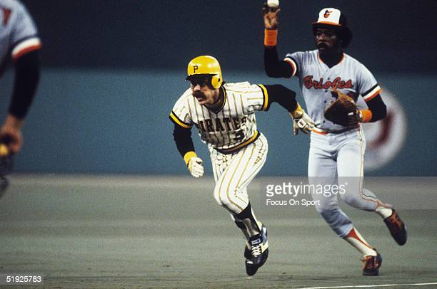 Pittsburgh Pirates' Phil Garner runs from Baltimore Orioles' Eddie Murray between bases during the World Series at Three Rivers Stadium in October of...