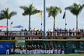 Pittsburgh Pirates players line up for the National Anthem before the game against the New York Yankees at McKechnie Field on March 5 2015 in...