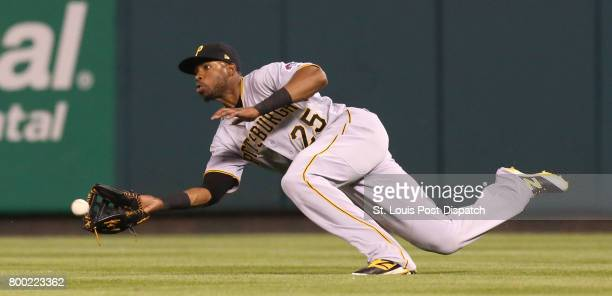 Pittsburgh Pirates right fielder Gregory Polanco dives to catch a line drive by the St Louis Cardinals' Jose Martinez and start a double play that...