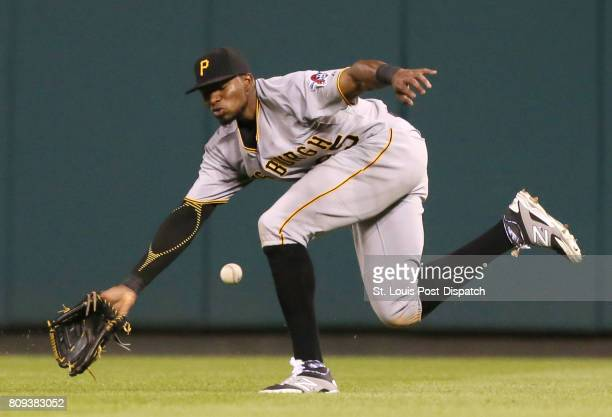 Pittsburgh Pirates right fielder Gregory Polanco is unable to field an RBI triple off the bat of the St Louis Cardinals' Yadier Molina in the sixth...