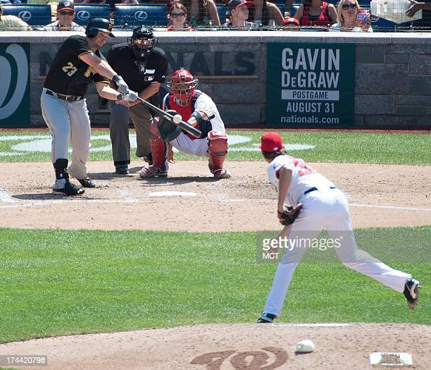 Pittsburgh Pirates right fielder Travis Snider gets a hit off Washington Nationals relief pitcher Tyler Clippard during the eight inning at Nationals...