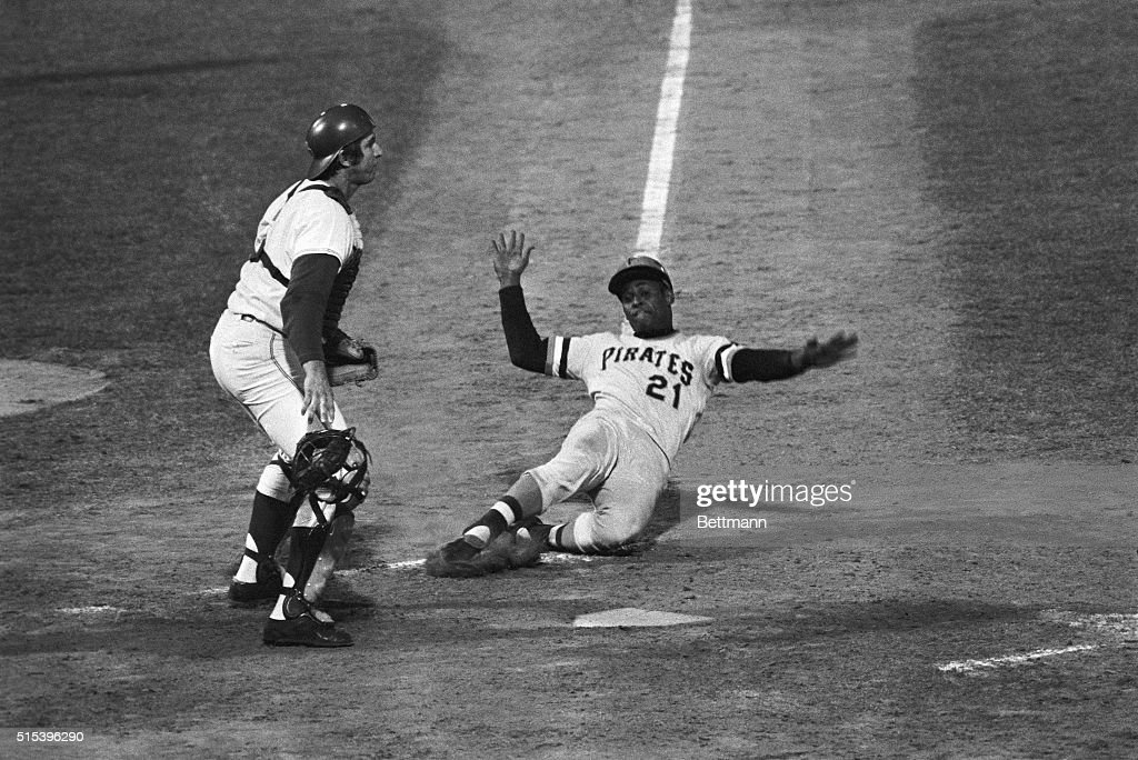 Pittsburgh Pirates' <a gi-track='captionPersonalityLinkClicked' href=/galleries/search?phrase=Roberto+Clemente&family=editorial&specificpeople=206918 ng-click='$event.stopPropagation()'>Roberto Clemente</a> (21) slides home in the seventh inning with the first run of the 9/10 game. Clemente scored all the way from second base on an infield hit by Richie Hebner. Montreal Expos' third baseman Bob Baily was charged with an error in an attempt to get Hebner out at first. Expos' catcher John Bateman (2) waits for the ball that never comes.