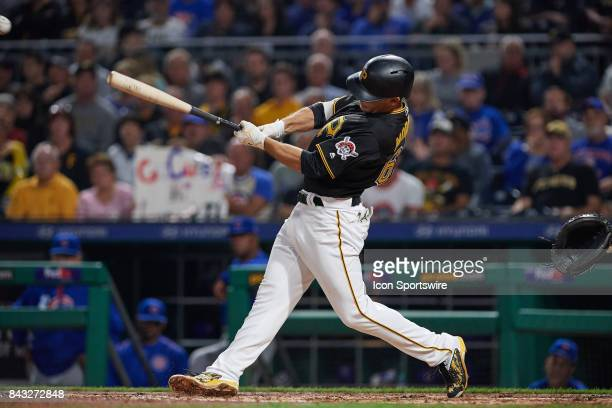 Pittsburgh Pirates second baseman Max Moroff connects for a single during an MLB game between the Pittsburgh Pirates and the Chicago Cubs on...
