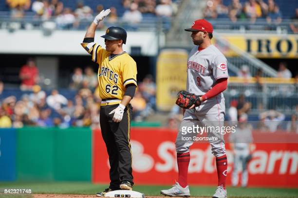 Pittsburgh Pirates second baseman Max Moroff safely reaches second base while Cincinnati Reds second baseman Jose Peraza waits for the ball during a...