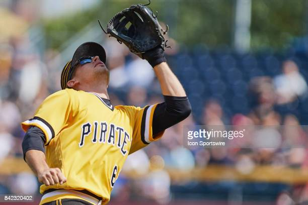 Pittsburgh Pirates second baseman Max Moroff watches a fly ball before acting it during a MLB game between the Pittsburgh Pirates and the Cincinnati...