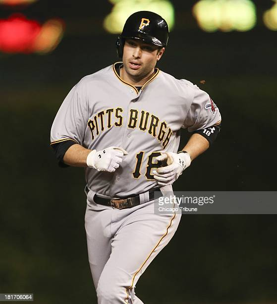 Pittsburgh Pirates second baseman Neil Walker rounds the bases after his home run against the Chicago Cubs during the first inning at Wrigley Field...