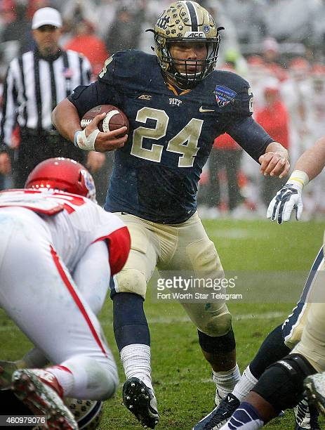 Pittsburgh running back James Conner heads for the goal line to score a touchdown in the first half against Houston in the Armed Forces Bowl at Amon...