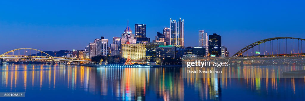 Pittsburgh skyline at blue hour from river bank